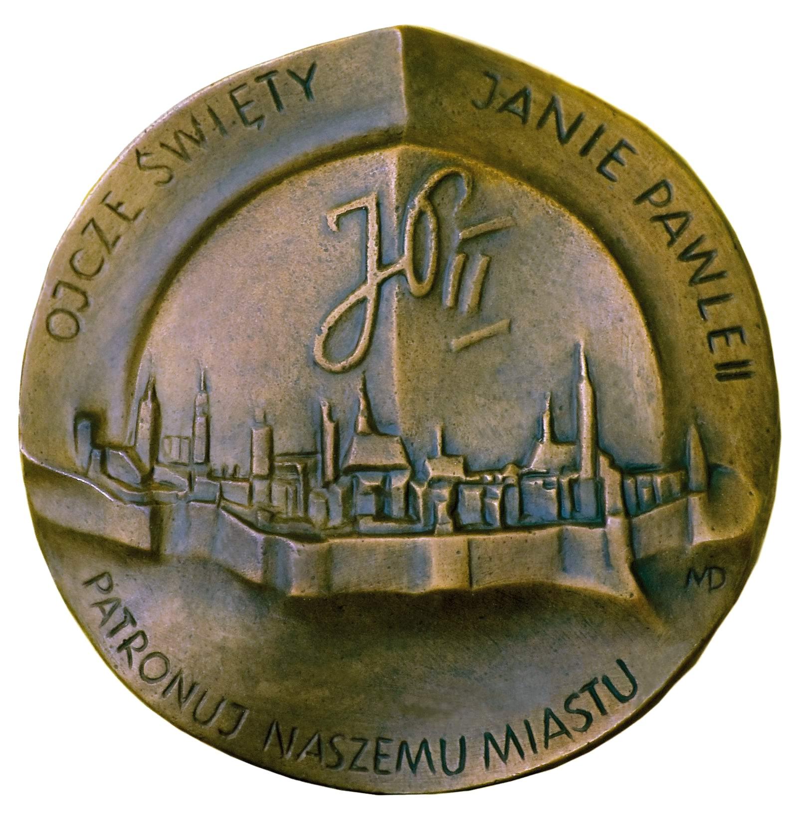 Magdalena Dobrucka, medal dwustronny (rewers), lany, srebro, Φ 85 mm, 2012 r.